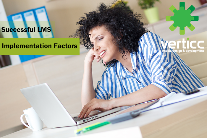 yound woman at computer and LMS Implementation Factors