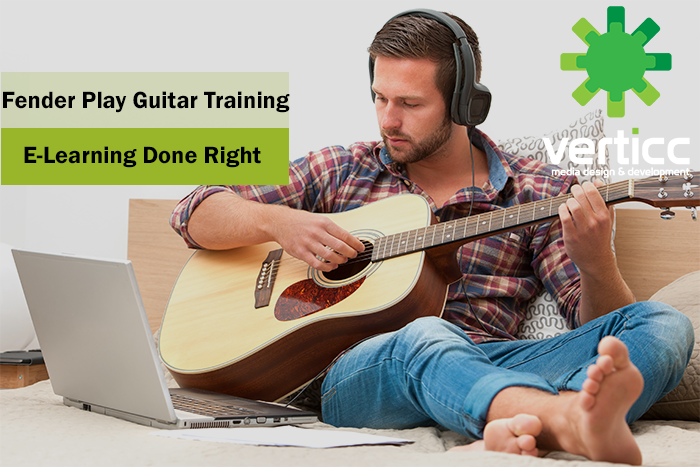 man learning guitar on computer